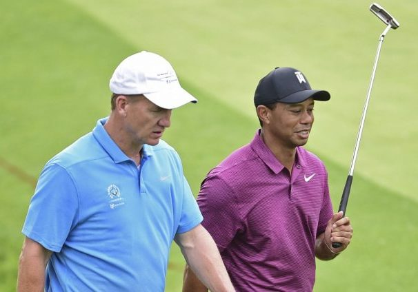 Tiger Woods and Peyton Manning Win